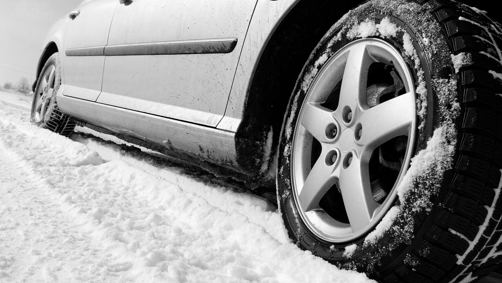 Car in Snow | Georgian Detailing | Barrie Exterior and Interior Auto Care